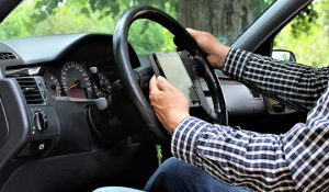 Using your mobile whilst driving – know the law